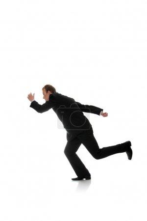Attractive athletic businessman running