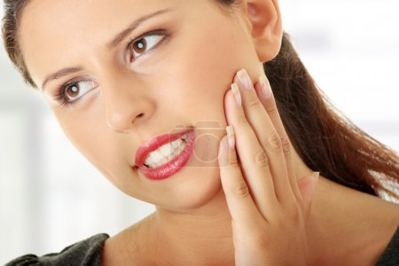 Young woman is having toothache