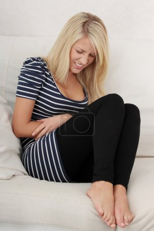 Blond woman with stomache issues