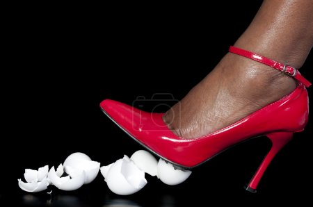 A woman in high heels walking on eggshells...