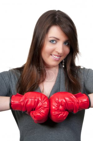 Photo for A beautiful young woman wearing a pair of boxing gloves - Royalty Free Image