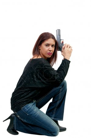 Photo for A young and beautiful woman police detective holding a handgun - Royalty Free Image