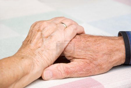 Photo for Senior couple holding hands in loce - Royalty Free Image