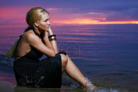 Sexy and luxury woman on the sunset background