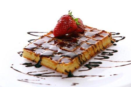 Fresh sweet chocolate waffles with strawberry