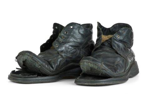 Photo pour Paire de vieilles bottes isolées sur le fond blanc - image libre de droit