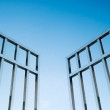 Iron gate open to the sky, concept of freedom...