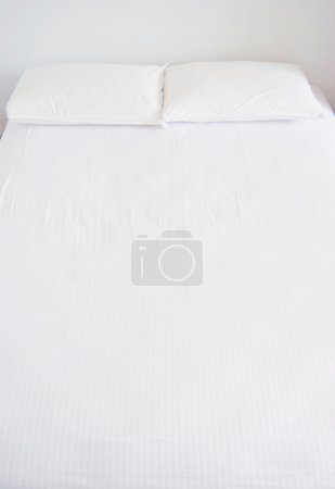 Photo for White pillows and bed in white bedroom - Royalty Free Image