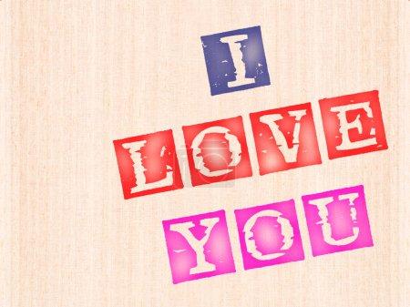 Photo pour Je t'aime, mots estampillés sur fond de bois . - image libre de droit