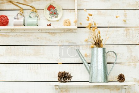Photo for Plants on white rough wooden wall as Decoration - Royalty Free Image