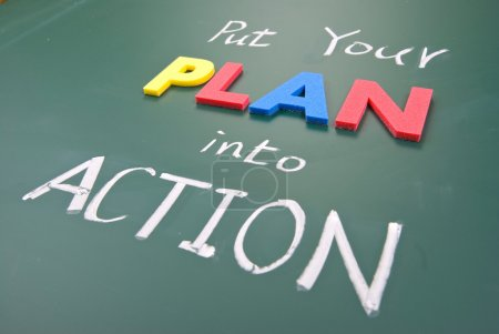 Photo for Put your plan into action, words on blackboard. - Royalty Free Image