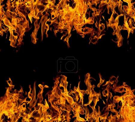 Foto de Marco de llamas de fuego sobre fondo negro - Imagen libre de derechos