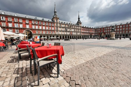 Photo for Cafe tables with red tableclothes in Plaza Mayor. Madrid. - Royalty Free Image