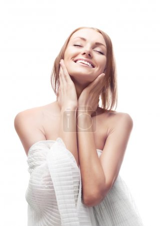 Photo for Beautiful happy young woman touching her face - Royalty Free Image