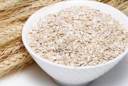 Porridge and Wheat ears on a white background