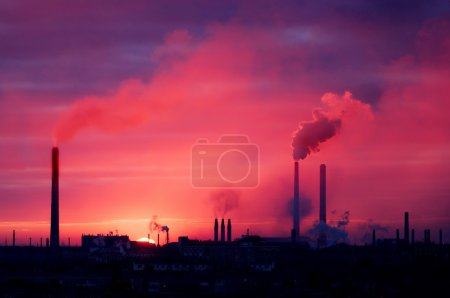 Factory silhouette on a rising sun
