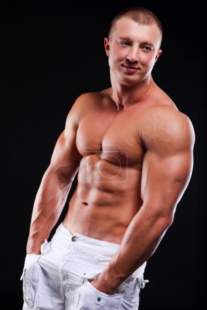 Photo for Young athletic man with perfect body of bodybuilder - Royalty Free Image