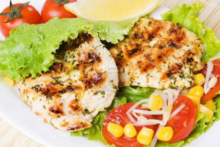 Photo for Grilled chicken breast served with tomato and lettuce - Royalty Free Image