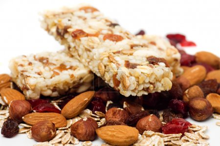 Photo for Granola bar with dried fruit and nuts on white background - Royalty Free Image