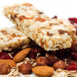 Granola bar with dried fruit and nuts on white bac...