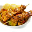 Grilled chicken meat with vegetables isolated on w...
