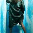 Woman from back wearning leather coat in neglected...