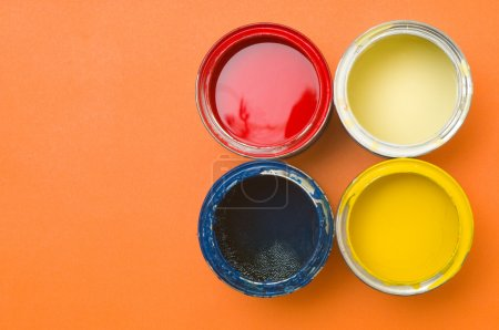 Colorful paints in tins