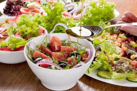 Photo for Healthy fresh salad with the addition of olive oil. - Royalty Free Image