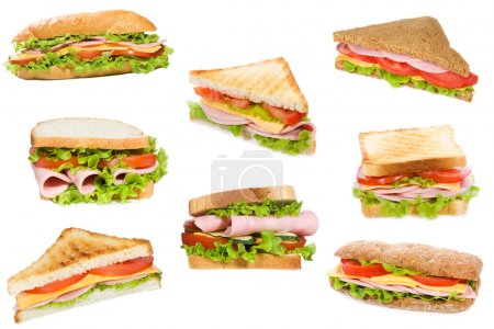 Sandwiches with ham and vegetables on white backgr...