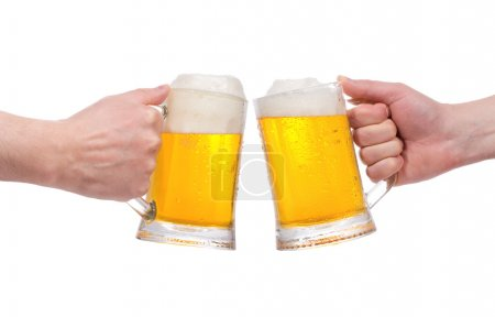 Hands with mugs of beer