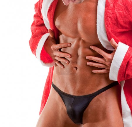 Photo for Muscular santa claus show his abs - Royalty Free Image
