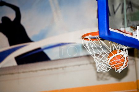 Photo for Basketball net and the ball which has got to it - Royalty Free Image