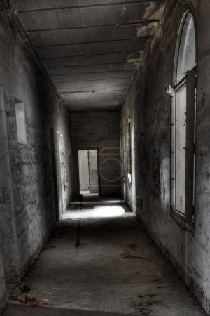 Photo for Dark and spooky corridor in an old abandoned building - Royalty Free Image