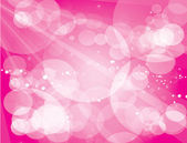 Abstract glowing light on a pink background