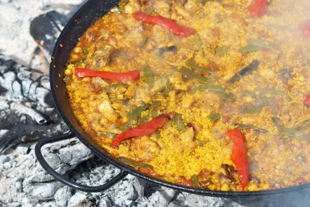 Traditional paella cooking