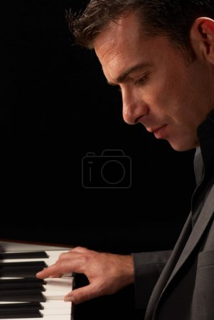 Photo for Elengant musician playing an electronic keybord, copy space available - Royalty Free Image