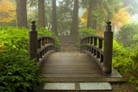 Photo for Wooden Bridge at Portland Japanese Garden in Fall One Foggy Morning - Royalty Free Image