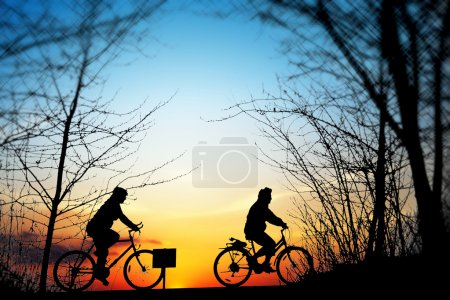 Cycling trip at sunset