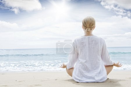 Photo for Portrait of young woman practicing yoga in summer environment - Royalty Free Image