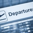 Close up view of airport departures sign blue tone...