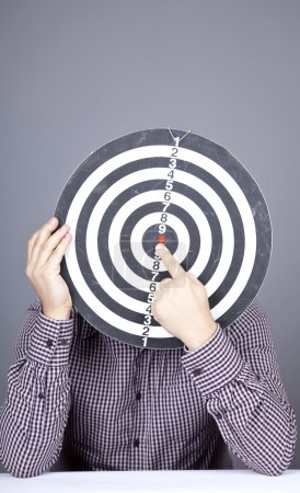 Boy with dartboard in place of head.