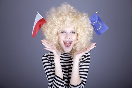 Beautiful girl with ringlets show European Union and Poland flag
