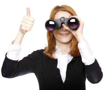 Business women seeking with binocular and show OK symbol.