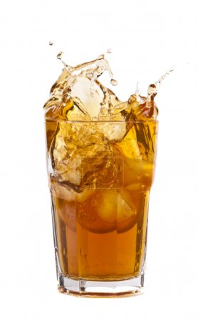 Photo for Ice cubes falling into ice tea with lemon - Royalty Free Image