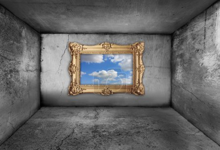 Gold frame, framing a blue sky from inside an old dirty room