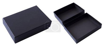 Photo pour Boîte-cadeau noire ouvert et fermé sur un fond blanc - image libre de droit
