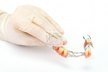 Photo for Dentures on a hand - Royalty Free Image