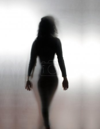 Photo for Silhouette woman walking away - Royalty Free Image