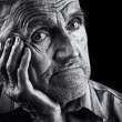 Monochrome stylized portrait of an expressive old ...
