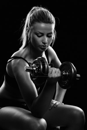 Photo for Athletic young lady doing workout with weights - Royalty Free Image